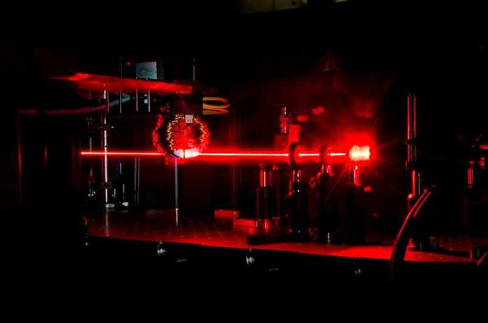 A beam of femtosecond laser pulses excites ultafast  processes in a magnetic material.